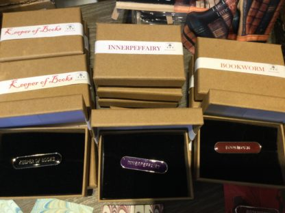 Pile of boxes with enamel badges