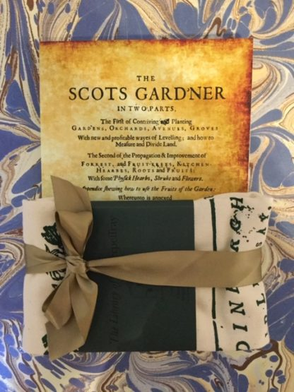 A gift pack containing the Scots Gard'ner book and a tea towel with images and text from the book