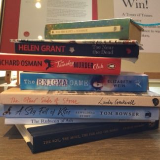 pile of books prize for quiz entry